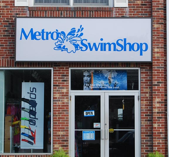 metro swimshop illuminated sign