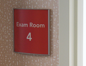 Exam room pan sign