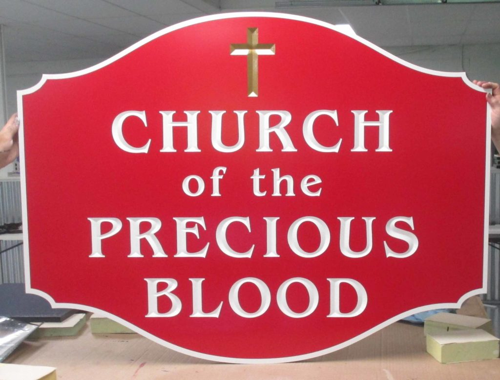 precious blood church carved sign